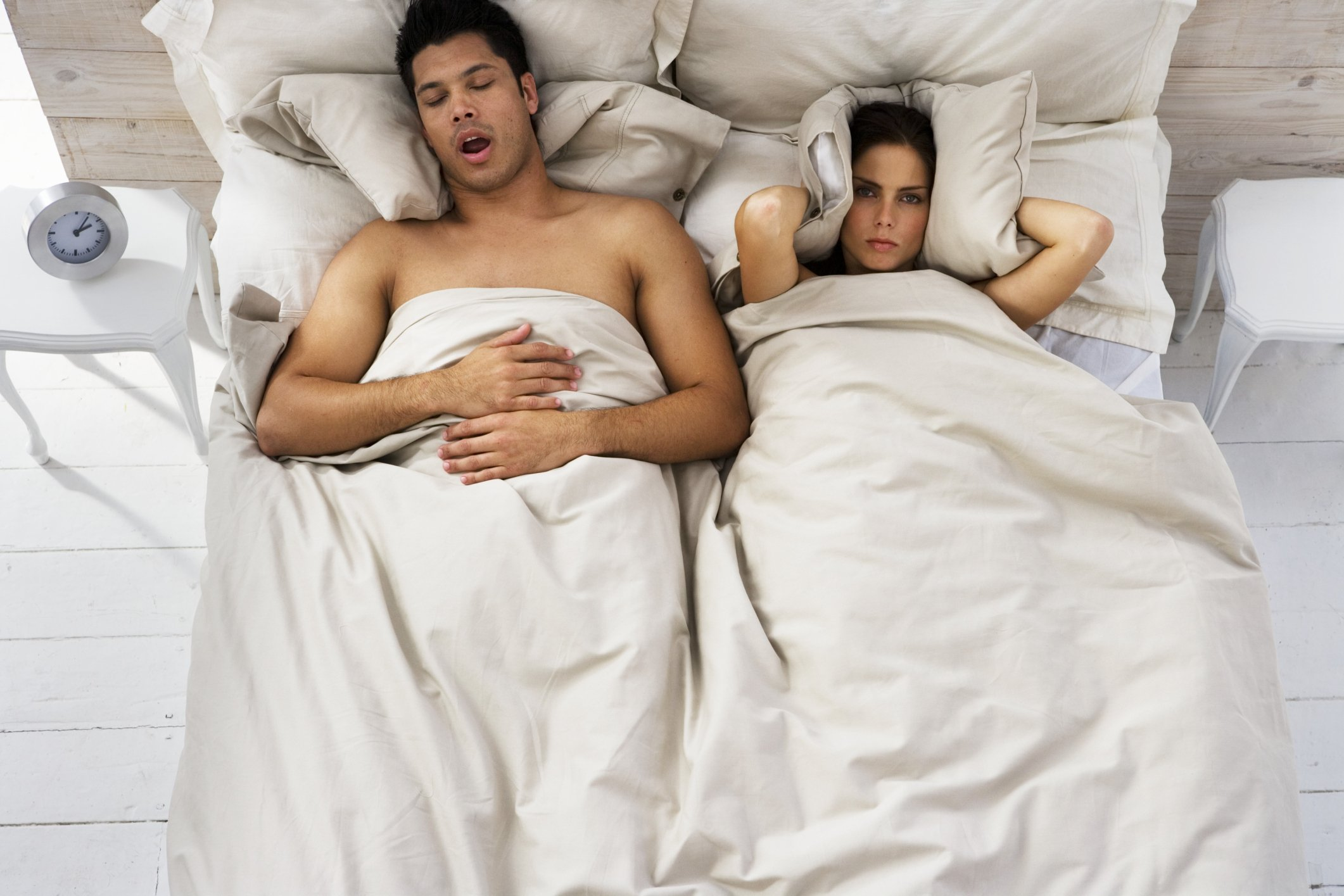 Woman Trying to Sleep While Man Snores